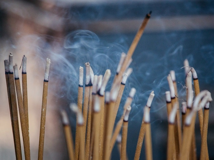 Burning incense for Tomb Sweeping Day