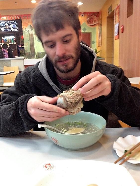 Dan enjoying the local food in Jiaxian in rural China.