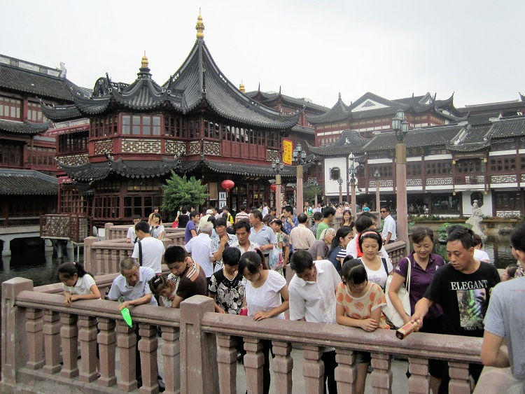 There's a way you can overcome any culture shock you might have in China. The secret? Meditation. Pictured: busy temple grounds in Shanghai.