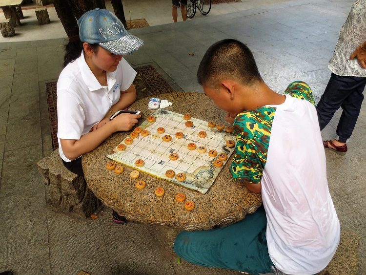 Watching people play chess while teaching in Shenzhen