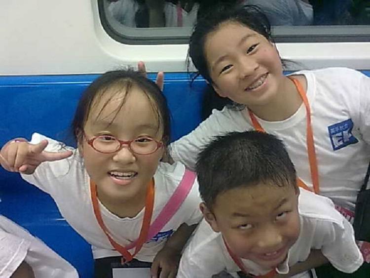 Three young students in China learning English.