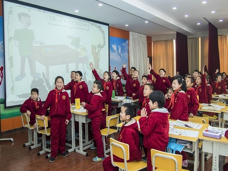 Students doing an activity in a classroom in China.