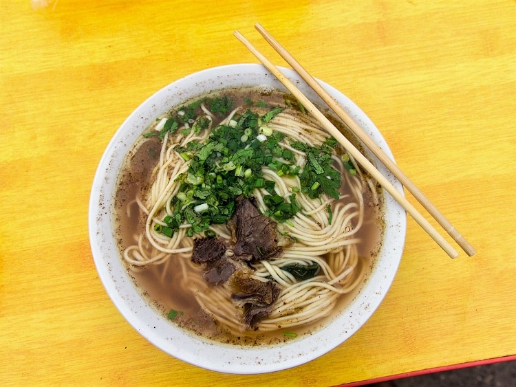 You can try Lamian hand-pulled noodles while teaching in China.