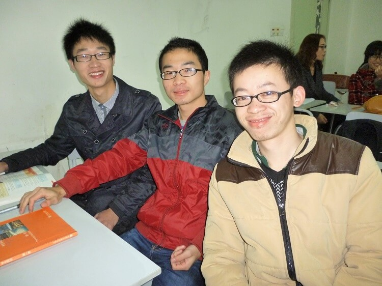 Three male Chinese students sitting at desk