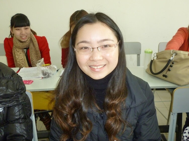 Chinese university student sitting in classroom