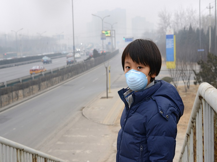 China Air Quality Index - boy wearing pollution mask