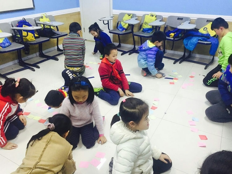 Kids playing classroom games in China