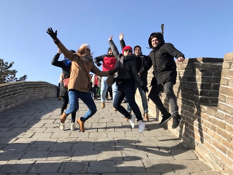 English teachers jumping in the air on the Great Wall of China