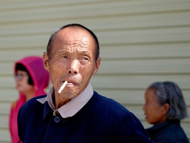Man smoking cigarette in China