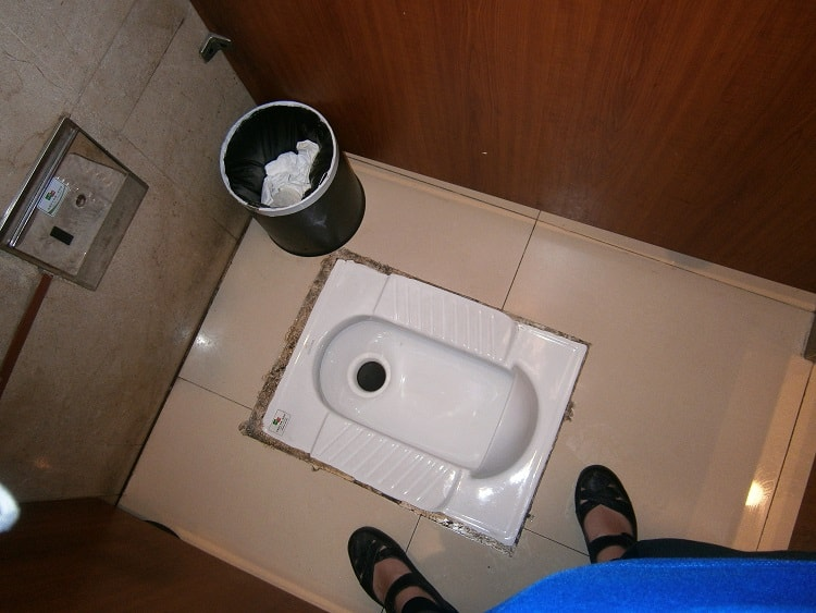Squat toilet in China - don't bring an inflexible attitude