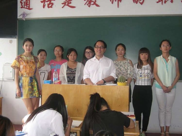 Teacher Kim teaching subjects in China.