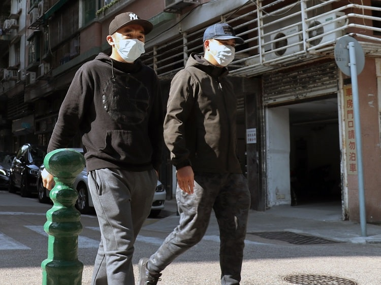 Two Chinese men wearing face masks due to coronavirus