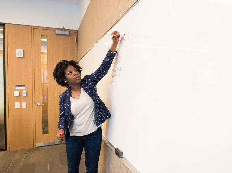 ESL teacher writing on whiteboard
