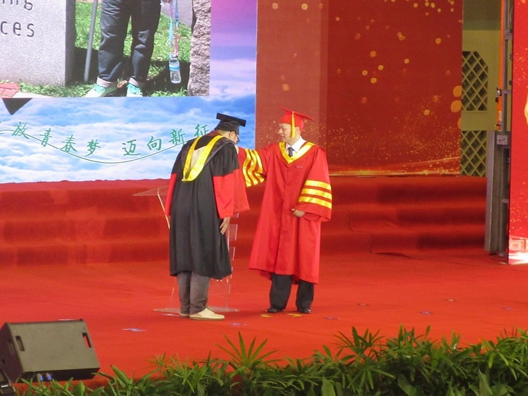 Being awarded at a postgraduate graduation ceremony China
