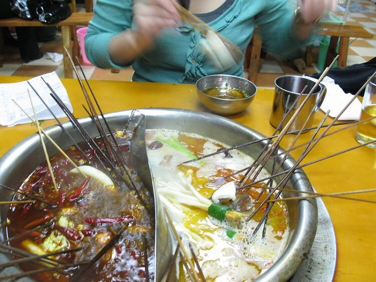 Eating spicy hotpot in China