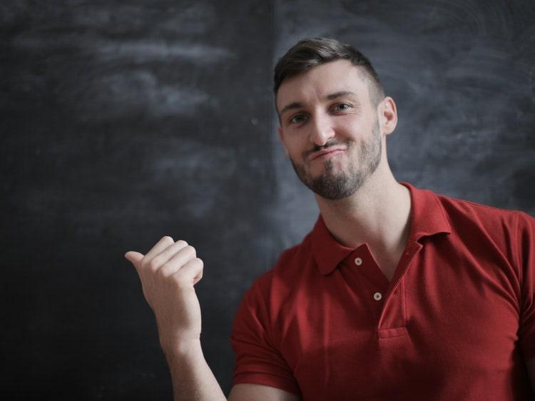 English teacher in front of blackboard