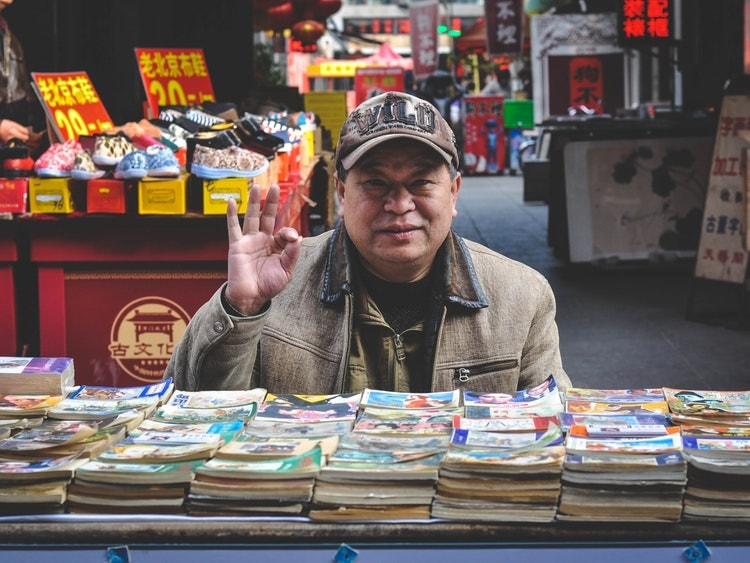 Chinese man selling books